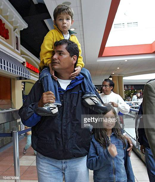 Ecuadorean presidential candidate Rafael Correa of the Country Alliance party goes for a walk with his two children in a shopping center in Quito 14...