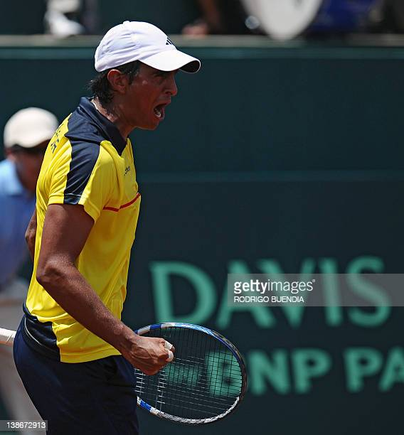 Ecuadorean tennis player Julio Camposano celebrates after wining a point against Colombia's Robert Farah during their Davis Cup match in Salinas...