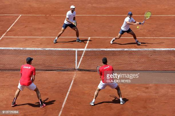 Ecuadorean tennis players Roberto Quiroz and Diego Hidalgo return the ball to Chilean players Nicolas Jarry and Hans Podlipnik during their Davis Cup...
