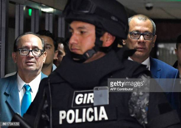 Ecuadorean Vice President Jorge Glas is escorted back to the court room next to his lawyer Eduardo Franco Loor during his habeas corpus hearing at...