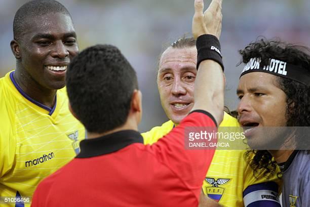 Ecuadoreans Giovanni Espinoza Alex Aguinaga and goalkeeper Jacinto Espinoza complaint to Venezuelan lineman Placido Chuello during their Copa America...