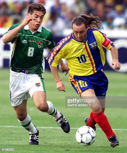 Ecuadorian player Alex Aguinaga takes the ball from Bolivian Ronald Garcia in Quito Ecuador 16 August 2000 Ecuador defeated Bolivia 20 in their...