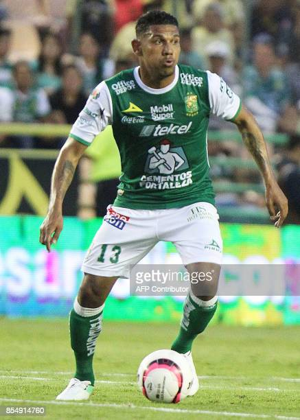 Ecuadorian player Angel Mena of Leon vies for the ball during their Mexican Apertura tournament football match against America at the Nou Camp...