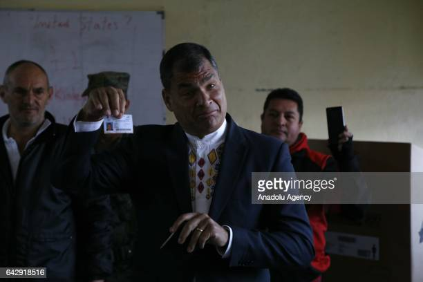 Ecuadorian President Rafael Correa shows his ballot after voting for the general elections at a polling station in Quito Ecuador on February 19 2017