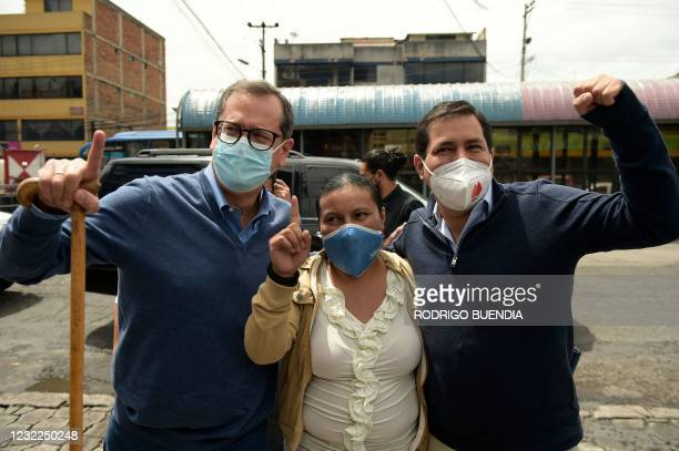 Ecuadorian presidential candidate Andres Arauz and his running mate Carlos Rabascall , accompany shopkeeper Silvia María Cusco , to vote at a polling...