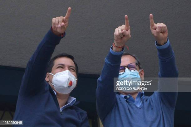 Ecuadorian presidential candidate Andres Arauz and his running mate Carlos Rabascall, wave to supporters at a polling station during the presidential...