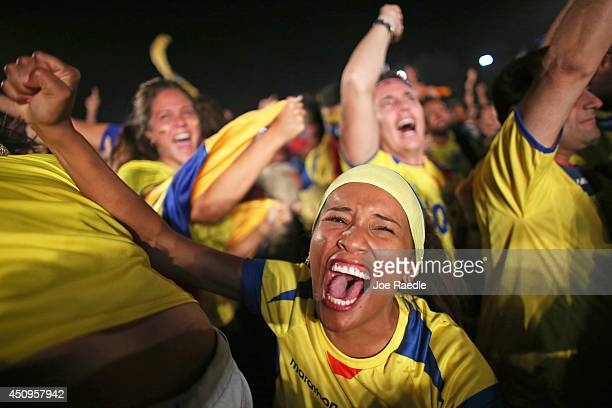 Ecuadorian soccer team fans react to their team scoring against the Honduras team as they watch on the screen setup at the Word Cup FIFA Fan Fest...