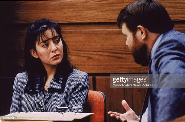 Ecuadorianborn Lorena Bobbitt listens to a lawyer during her trial Manassas Virginia January 1994 Bobbitt was on trial for cutting off her husband's...