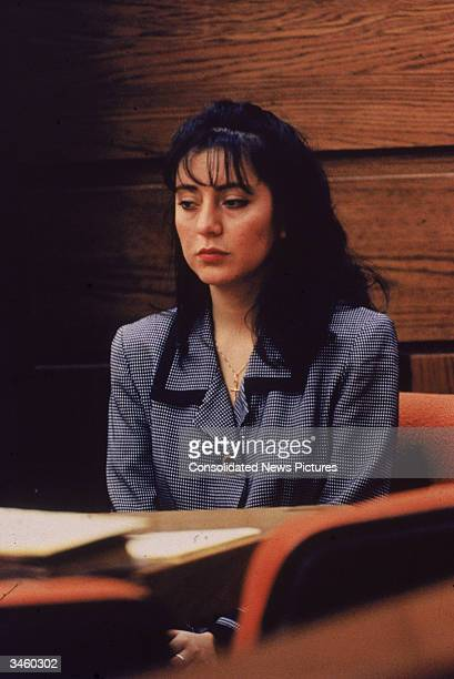 Ecuadorianborn Lorena Bobbitt sits at a table during her trial Manassas Virginia January 1994 Bobbitt was on trial for cutting off her husband's...
