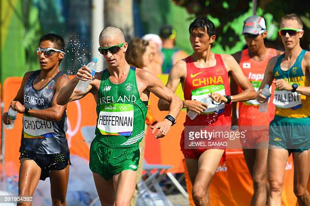 Ecuador's Andres Chocho Ireland's Robert Heffernan China's Yu Wei and Australia's Jared Tallent compete in the Men's 50km Race Walk during the...