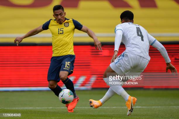 Ecuador's Angel Mena and Uruguay's Ronald Araujo vie for the ball during their 2022 FIFA World Cup South American qualifier football match at the...
