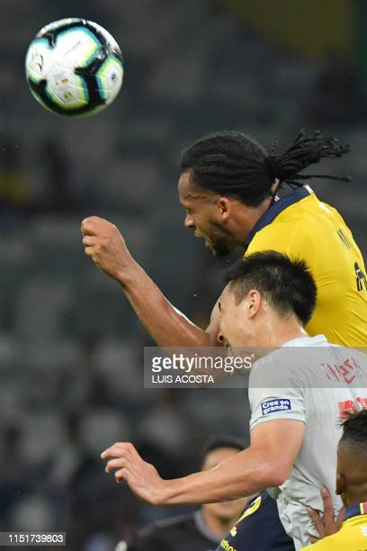 Ecuador's Arturo Mina and Japan's Shinji Okazaki vie for the ball during their Copa America football tournament group match at the Mineirao Stadium...