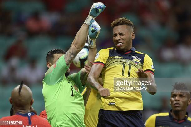 Ecuador's Ayrton Preciado tries to score next to Chile's goalkeeper Gabriel Arias during their Copa America football tournament group match at the...