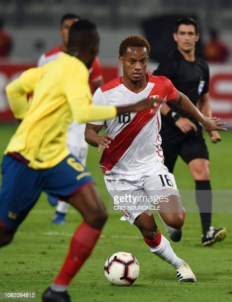 Ecuadors Beder Caicedo vies for the ball with Peru's Andre Carrillo during a friendly football match at the National Stadium in Lima on November 15...