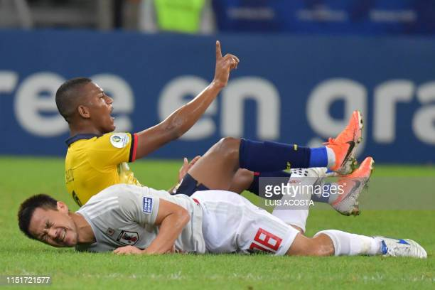 Ecuador's Carlos Gruezo and Japan's Shinji Okazaki lie on the ground during their Copa America football tournament group match at the Mineirao...