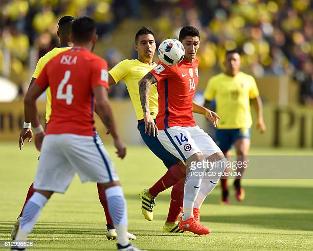 Ecuador's Christian Noboa and Chile's Pedro Pablo Hernandez vie for the ball during their Russia 2018 World Cup football qualifier match in Quito on...