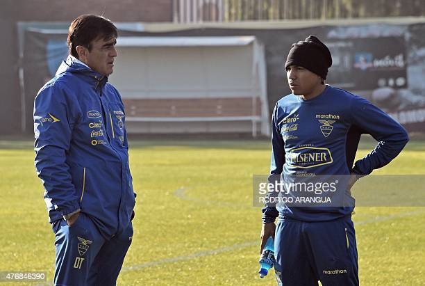 Ecuador's coach Gustavo Quinteros speaks with player Jonathan Gonzalez during a training session in Santiago on June 12 during the second day of the...