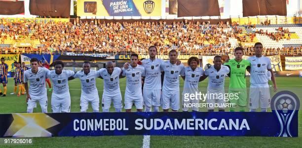 Ecuador´s Deportivo Cuenca football team players pose before their Copa Sudamericana football match against Paraguay's Sportivo Luqueno at the...