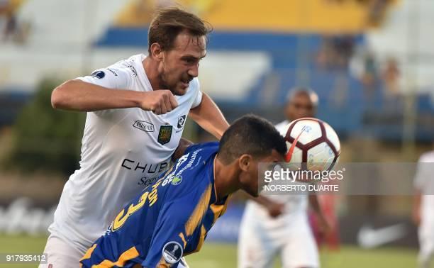 Ecuador's Deportivo Cuenca player Brian Cucco vies for the ball with Omar Leguizamon of Paraguay's Sportivo Luqueno during their Copa Sudamericana...