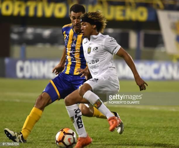 Ecuador's Deportivo Cuenca player Carlos Quinonez vies for the ball with Joel Benitez of Paraguay's Sportivo Luqueno during their Copa Sudamericana...