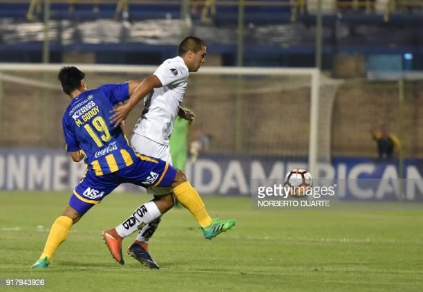 Ecuador's Deportivo Cuenca player Facundo Melivillo vies for the ball with Miguel Godoy of Paraguay's Sportivo Luqueno during their Copa Sudamericana...