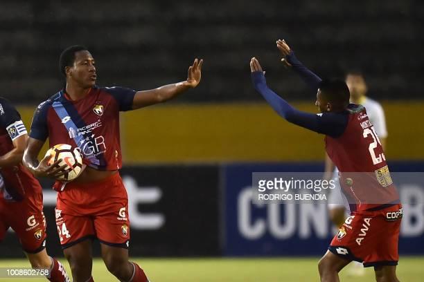 Ecuador's El Nacional player Daniel Angulo celebrates with a teammate after scoring against Defensa y Justicia of Argentina during their Copa...