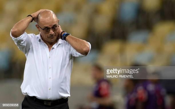 Ecuador's Emelec coach Alfredo Arias gestures during a Copa Libertadores 2018 football match against Brazil's Flamengo at Maracana Stadium in Rio de...