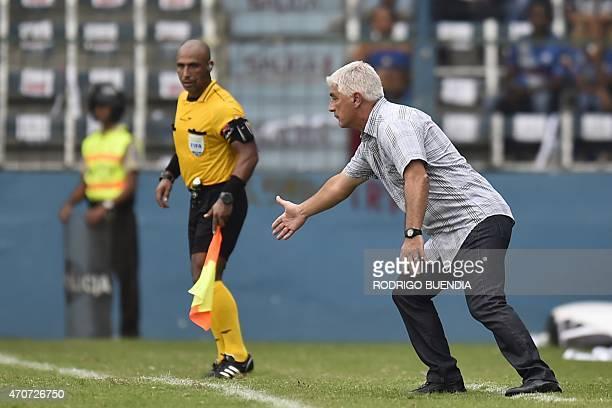 Ecuador's Emelec coach Omar De Felippe gestures during their Copa Libertadores football match against Universidad de Chile at George Capwell stadium...