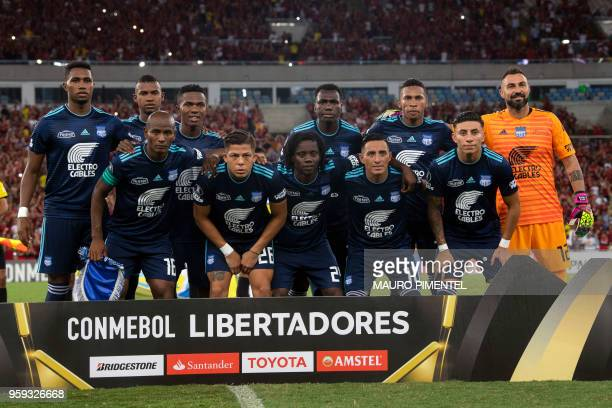 Ecuador's Emelec team players pose for pictures before the start of their Copa Libertadores 2018 football match against Brazil's Flamengo at Maracana...