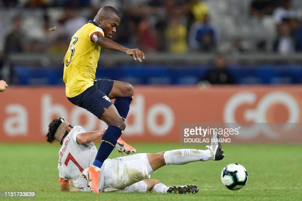 Ecuador's Enner Valencia and Japan's Gaku Shibasaki vie for the ball during their Copa America football tournament group match at the Mineirao...