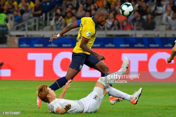 Ecuador's Enner Valencia and Japan's Ko Itakura vie for the ball during their Copa America football tournament group match at the Mineirao Stadium in...