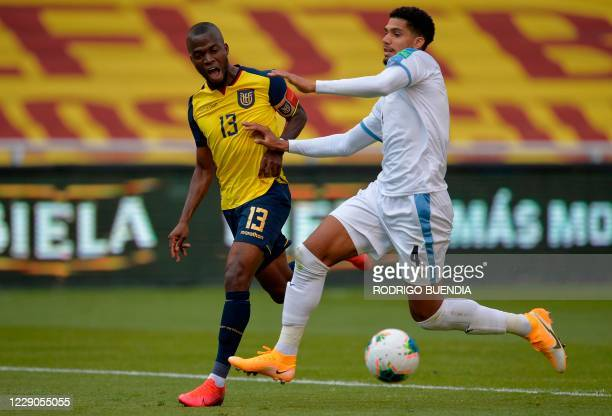 Ecuador's Enner Valencia and Uruguay's Ronald Araujo vie for the ball during their 2022 FIFA World Cup South American qualifier football match at the...