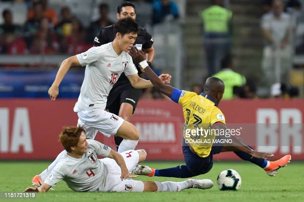 Ecuador's Enner Valencia is marked by Japan's Takehiro Tomiyasu and Ko Itakura during their Copa America football tournament group match at the...