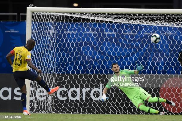 Ecuador's Enner Valencia scores a penalty past Chile's goalkeeper Gabriel Arias during their Copa America football tournament group match at the...