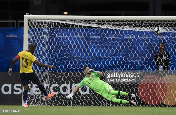 TOPSHOT Ecuador's Enner Valencia scores a penalty past Chile's goalkeeper Gabriel Arias during their Copa America football tournament group match at...