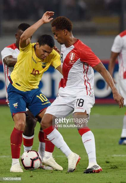 Ecuadors Enner Valencia vies for the ball with Peru's Andre Carrillo during a friendly football match at the National Stadium in Lima on November 15...