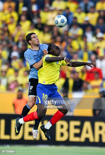 Ecuador's Felipe Caicedo figths for the ball with Uruguay's Andres Scotti during their FIFA 2010 World Cup Qualifying match at Atahualpa Stadium on...