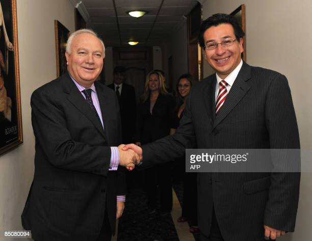Ecuador's Foreign Minister Fander Falconi shakes hands with his Spanish counterpart Miguel Angel Moratinos in Quito on February 25 2009 Moratinos is...