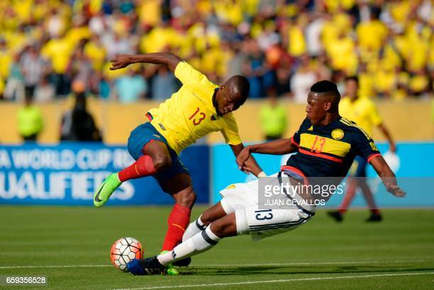 Ecuador's forward Enner Valencia vies for the ball with Colombia's defender Yerry Mina during their 2018 FIFA World Cup qualifier football match in...