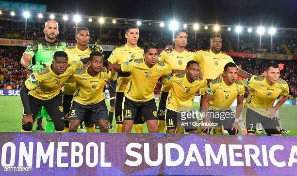 Ecuador´s Fuerza Amarilla football team players pose before their Sudamericana Cup football match against Colombia's Santa Fe at El Campin stadium in...
