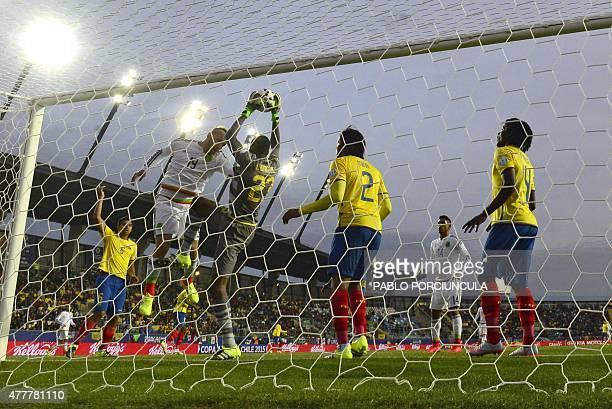 Ecuador's goalkeeper Alexander Dominguez catches the ball next to Mexico's forward Matias Vuoso during the 2015 Copa America football championship...