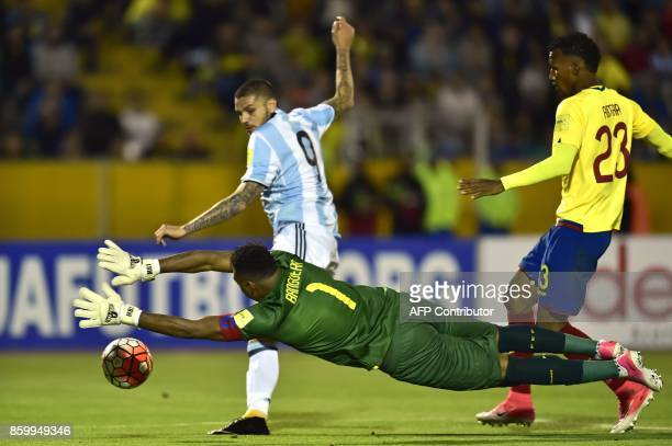 Ecuador's goalkeeper Maximo Banguera dives for the ball to prevent Argentina's Mauro Icardi from scoring during their 2018 World Cup qualifier...