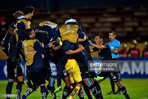 Ecuador's Independiente del Valle goalkeeper Hamilton Piedra is embraced by teammates as they celebrate winning a Copa Sudamericana football match...