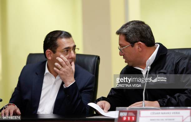 Ecuador's Interior Minister Cesar Navas and Defence Minister Patricio Zambrano talk during a press conference in which they confirmed the kidnapping...
