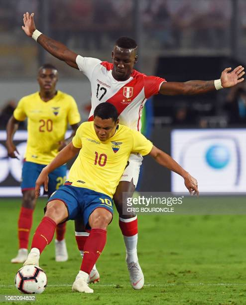 Ecuadors Jefferson Montero vies for the ball with Peru's Luis Advincula during a friendly football match at the National Stadium in Lima on November...
