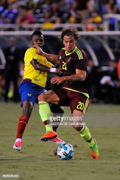 Ecuador's Juan Casares fights for the ball against Venezuela's defender Rolf Feltscher during their friendly soccer match at FAU stadium in Boca...