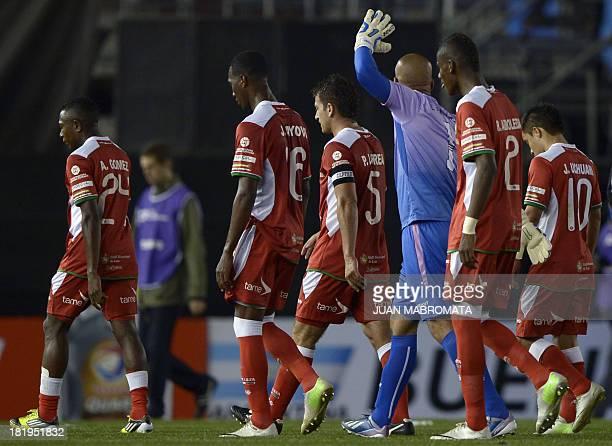 Ecuador's Liga de Loja footballers leave the field at half time of the Copa Sudamericana 2013 round before quarterfinals second leg football match...