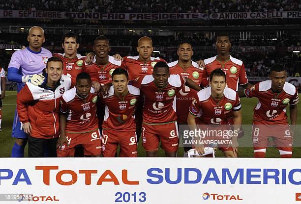 Ecuador's Liga de Loja team poses during their Copa Sudamericana 2013 round before quarterfinals second leg football match against Argentina's River...