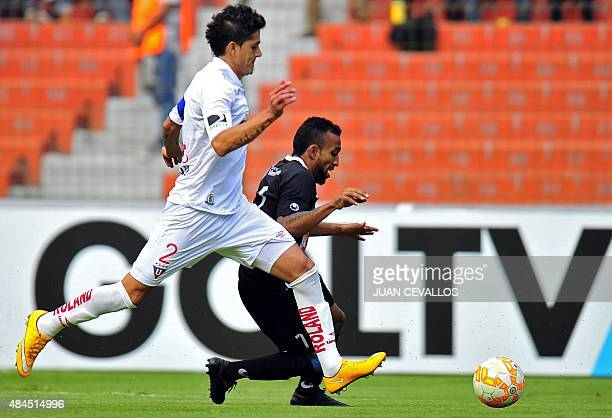 Ecuador's Liga de Quito Norberto Araujo vies for the ball with Venezuela's Zamora Ynmer Eliezer Gonzalez during their Copa Sudamericana football...