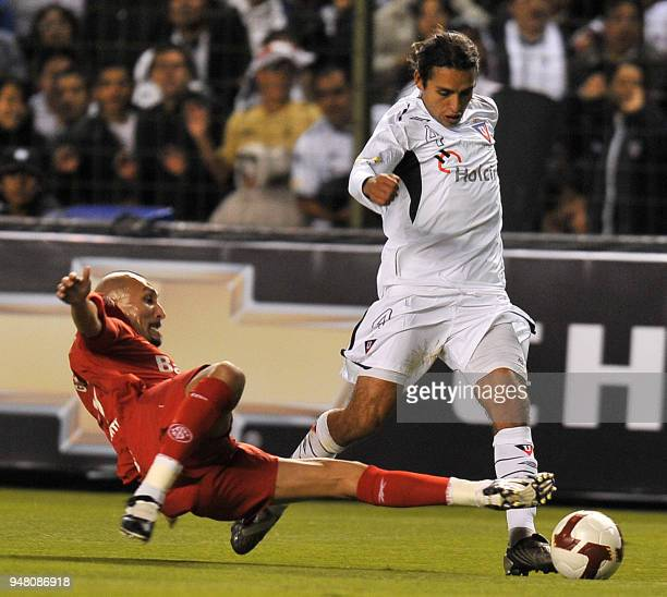 Ecuador's Liga de Quito player Paul Ambrossi is marked by Brazil's Internacional player Pablo Guinazu during their second leg 2009 Recopa...